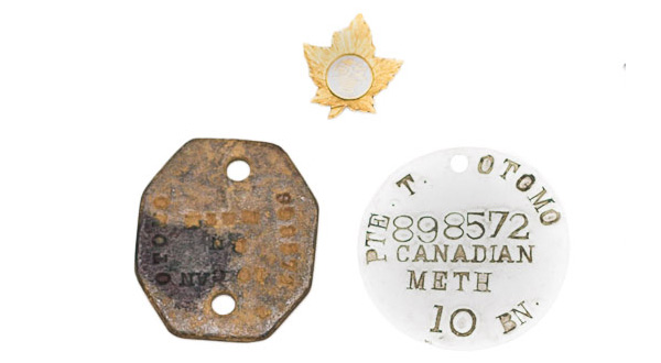 Private Toshimitsu Otomo's military identification discs, 1916. Toshimitsu Otomo collection, NNM 2016.23.1.2.1-2.