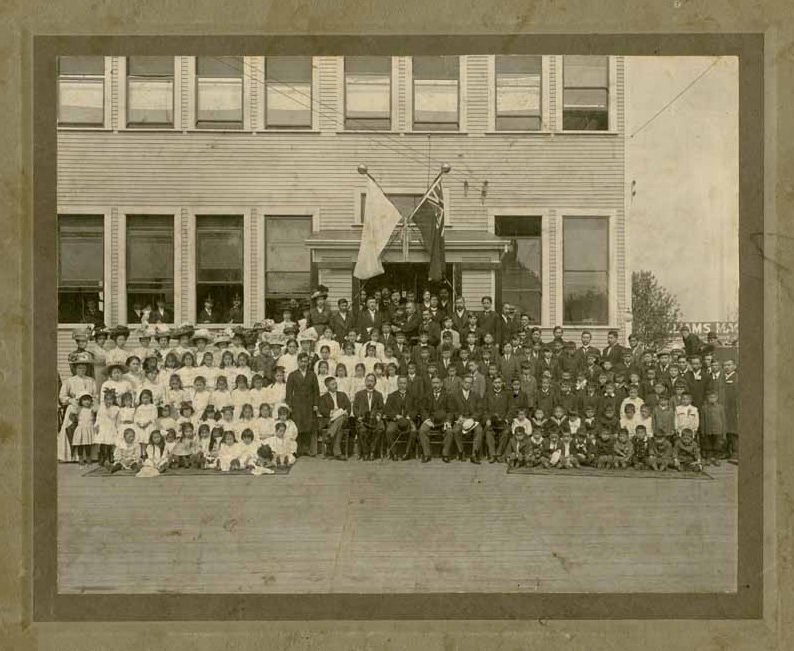 Group photograph with Admiral Togo in front of the Vancouver Japanese Language School during his visit to Vancouver, 1911. Loan courtesy of Ken Noma.
